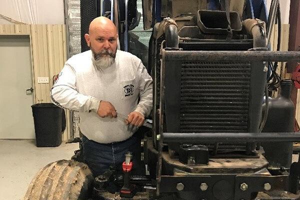 Stephen Smith mechanic Small Farm Innovations farm equipment dealers